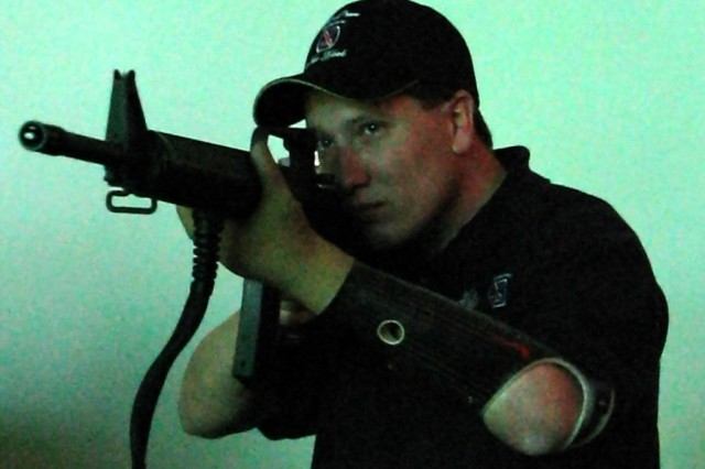 Army Sgt. Dennis Cline learns to use his prosthesis while firing a weapon in the Fire Arms Training System at Walter Reed Army Medical Center. A longtime outdoorsman, Cline is happy to be able to return to the sport of hunting.