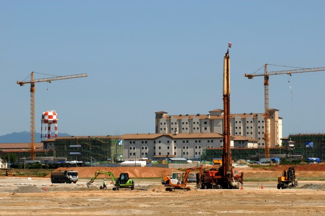 Contractors fill in what used to be rice paddies for building around Camp Humphreys, South Korea. In the background, new barracks are being built on a site that a decade ago was a tent city used during training at the camp.
