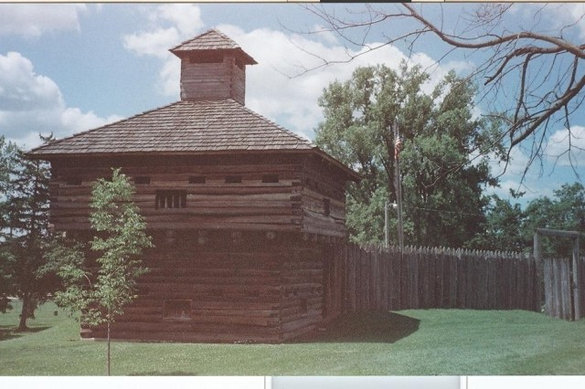 The blockhouses are connected by wooden pickets that provide adequate protection from Indian musket and rifle fire.