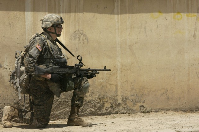 Pfc. Benjamin Cunningham provides security for fellow Soldiers during a halt.