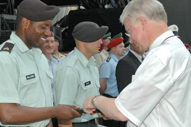 Hessen Minister President Roland Koch awards a community gift to Sgt. Harry Williams, 501st Military Police Company, during a special ceremony honoring outstanding U.S. Soldiers and civilians in Butzbach, Germany.