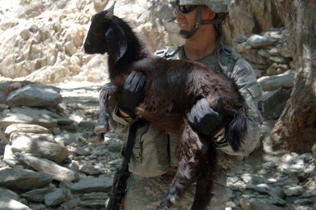 Spc. Patrick Keepers makes a friend in the village of Balik.