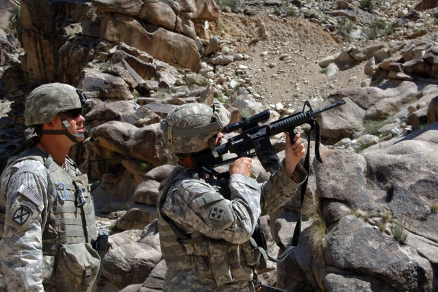 Spc. Patrick Keepers and Sgt. Jeremy Kingsbury watch the ridgeline for extremists that might be lurking in Titan Valley.
