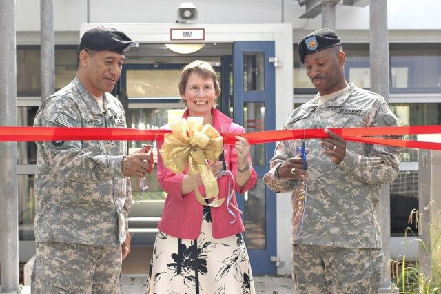 From left, Command Sgt. Maj. Iuniasolua Savusa, U.S. Army, Europe; Region Librarian Meg Tulloch; and Command Sgt. Maj. John Gaines, Installation Management Command-Europe, officially open the European Regional Library and Support Center at Heidelberg, Germany.