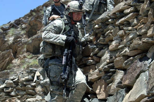 2nd Lt. Jonathon Reabe, from the Provincial Reconstruction Team, leads his Soldiers down a mountain during a patrol of Balik in Nuristan Province, Afghanistan, June 14.