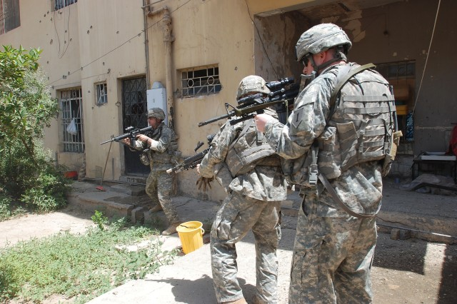 Soldiers clear insurgents from a courtyard where they'd retreated.