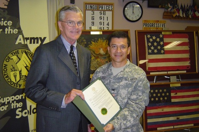 Topeka City Mayor, Bill Bunten (left) presents Col. Jose R. Davis, President of the Topeka Chapter of the Association of the United States Army (AUSA) a City Proclamation for United States Army Day in Topeka, KS in honor of the Army's 232nd Birthday during a ceremony at the American Legion Post #1, Topeka, KS.