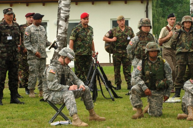 Sergeants major from nations throughout Europe and Eurasia observe a block of instruction at the Joint Multinational Training Command Warrior Leader Course, as part of a tour of training facilities in Grafenwoehr, Germany, during the Noncommissioned Officers Conference of European Armies. June 20-22.