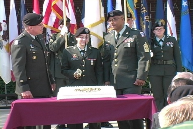PFC Nicole Murphy, 705th Military Police Battalion and youngest Soldier on Fort Leavenworth, prepares to cut the Army Birthday cake during the Fort Leavenworth Army Birthday ceremony with Brig. Gen. Mark E. O'Neill, acting commanding general of the Combined Arms Center and Fort Leavenworth, and Command Sgt. Maj. Johnnie Jones, United States Disciplinary Barracks.  The June 14 ceremony took place at Fort Leavenworth on Abrams Loop in front of Bell Hall.