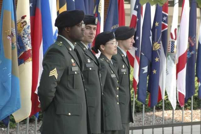 Sgt. Daryl Jones, 705th Military Police Battalion, Sgt. Oleg Kravchenko, 705th Military Police Battalion,  Spc. Eun O'Grady, MEDDAC, and Pfc. Justin Hudgens, Special Troops Battalion, await their turn to make presentations during the Fort Leavenworth Army Birthday ceremony on June 14.  The ceremony took place on Fort Leavenworth at Abrams Loop in front of Bell Hall.