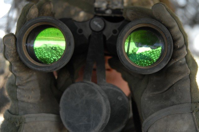 Spc. John Galebach scans the horizon in Baqubah, Iraq, June 19, while standing rear guard atop a Stryker vehicle. He is with Company C, 2nd Battalion, 1st Infantry Regiment, 3rd Brigade Combat Team, 2nd Infantry Division.