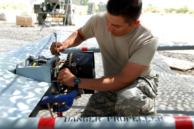"Army Staff Sgt. Pablo Villanueva, Bravo Company, 173rd Special Troops Battalion (Airborne) conducts ""preventive maintenance daily"" on a RQ-7 Shadow 200 Unmanned Aerial Vehicle June 19 on Forward Operating Base Fenty in Jalalabad, Afghanistan."