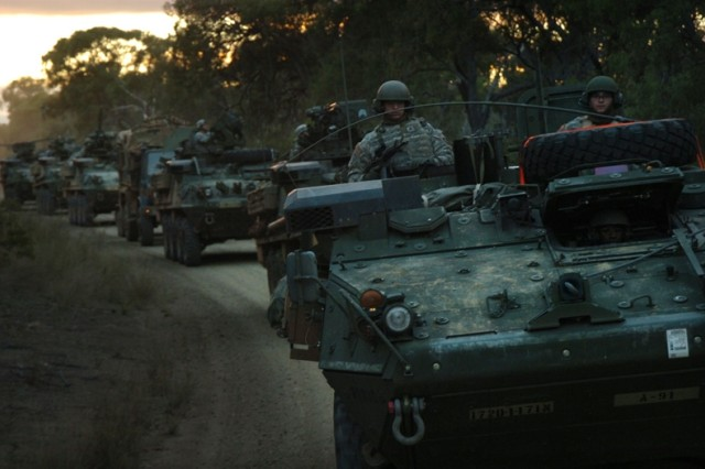 Soldiers roll to their next objective in their Stryker vehicles.