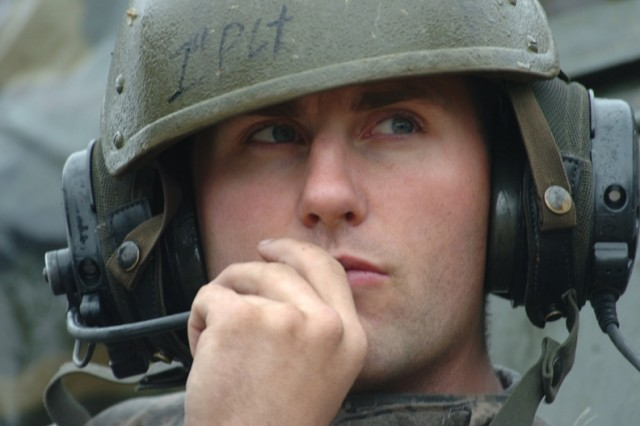 1st Lt. Luke Booth monitors communications.