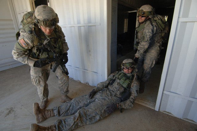 Soldiers extract a role-playing wounded comrade.