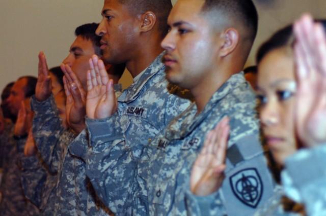 Capt. Kirk Thorsteinson, 3rd Battalion, 297th Infantry Regiment, during a naturalization ceremony in Kuwait, June 29.