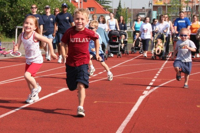 Children sprint down the Bamberg Freedom Fitness Facility track, eager to begin logging miles in support of troops in Iraq and Afghanistan during the Operation Walk 4 Freedom program.
