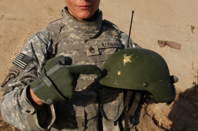Staff Sgt. Kyle Keenan, section leader with 1st Squadron, 89th Cavalry Regiment, 2nd Brigade Combat Team, 10th Mountain Division (Light Infantry), points out the lifesaving characteristics of his Advanced Combat Helmet. Staff Sgt. Keenan was shot in the helmet at point-blank range by a 9mm pistol on a mission July 1.