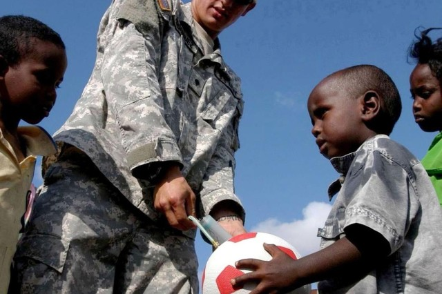 Spc. Lester Rodriquez pumps up soccer balls that will be given to children in the Damerjong district of Djibouti. Spc. Rodriquez is with the 350th Civil Affairs Company.