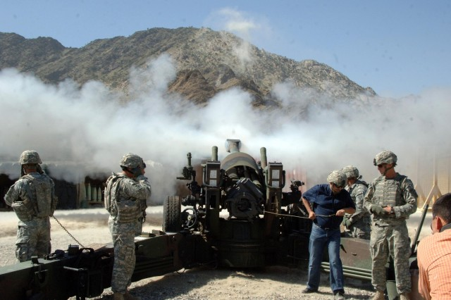 Soldiers fire an M198 155mm howitzer during a training exercise.