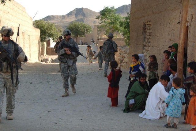 Soldiers patrol the village of Kowtalay.