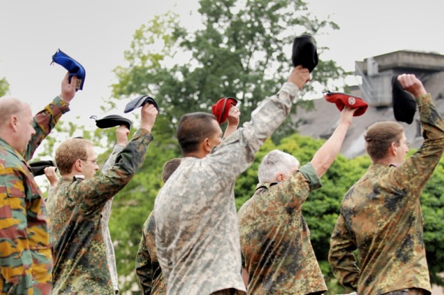 Soldiers from the NATO's Allied Land Component Command Headquarters, Heidelberg give a cheer during their deployment ceremony July 6 on Campbell Barracks. About 200 Soldiers and civilian employees are deploying to Afghanistan for six months to serve as the headquarters element for NATO's 37,000-Soldier International Security Assistance Force in Kabul.
