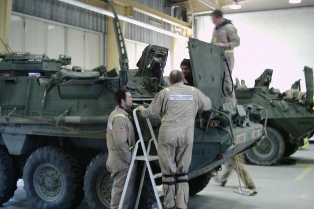 GDLS/M&E retrofit specialists work on a 2nd SCR Stryker.