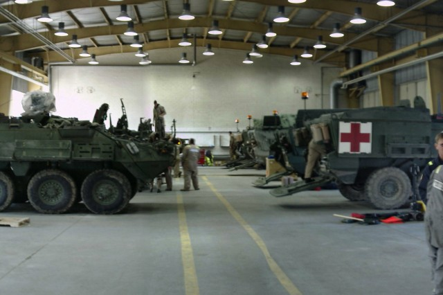 This panoramic view of the Stryker retrofit facility features General Dynamics Land Systems and M & E retrofit specialists working on the vehicles.