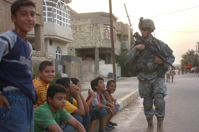 Children are relaxed with the Soldier's presence.