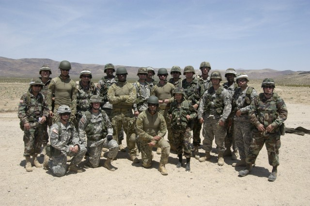 Actors Josh Duhamel, Tyrese Gibson, Amaury Nolasco and Zack Ward pose with Soldiers from the National Training Center Support Brigade on range 2 at Fort Irwin in May 2006. The four actors spent two days at the NTC preparing for their roles in the upcoming Michael Bay film Transformers.