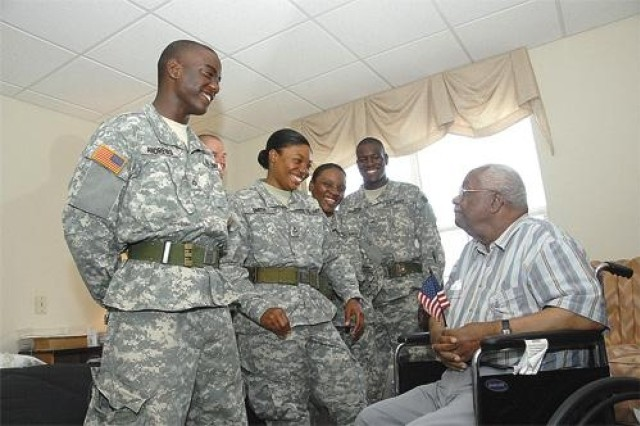 AIT Soldiers visit with senior citizen, Veterans at an assisted living facility in Hopewell, Va.