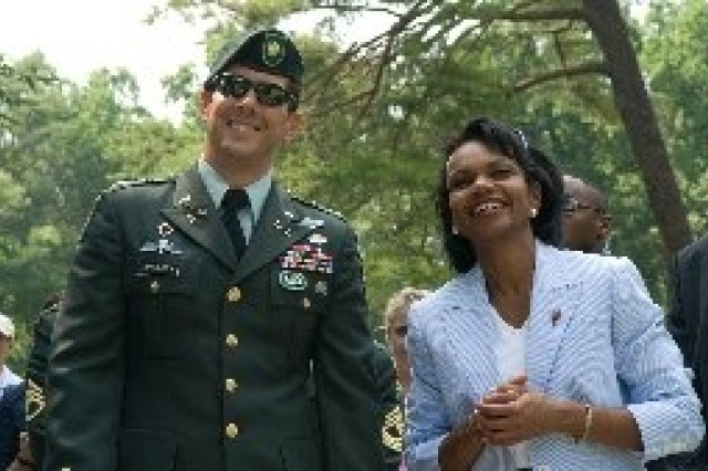 U.S. Army Maj. Jim Gregory, commanding officer of the 3rd Special Forces Group, shares a light moment with Secretary of State Condoleezza Rice at the AT&T National golf tournament, July 6, 2007, in Bethesda, Md. Gregory's detachment recently returned from Afghanistan.