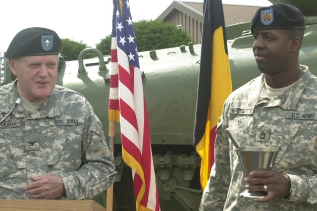 Chaplain (Col.) Sidney Marceaux, U.S. Army Garrison Benelux chief of chaplains, with the help of Sgt. 1st Class Murphy Morissette, prepares to bless ceremonies marking the start of several quality-of-life projects here.
