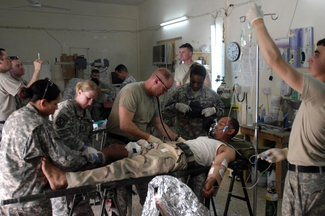 Medical personnel from the 10th Mountain Division treat a wounded Iraqi Soldier in Mahmudiyah.