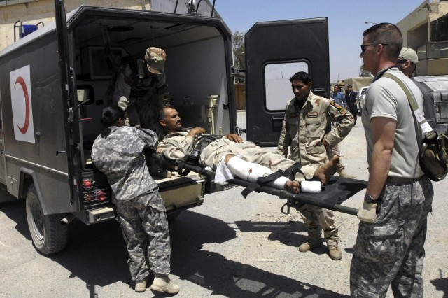U.S. and Iraqi security forces evacuate a wounded Soldier near Baghdad.