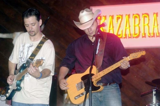 Matt Poss & the Wild Bunch lead guitarist Marty Williamson, left, and lead singer Matthew Passalacqua perform at Vogelweh's Kazabra Club.