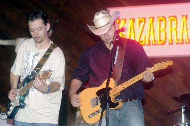 Matt Poss & the Wild Bunch lead guitarist Marty Williamson, left, and lead singer Matthew Passalacqua perform at Vogelweh's Kazabra Club.