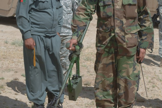 An Afghan National Army Soldier and police officer practice searching for mines after receiving a mine-clearing class from Soldiers with the 82nd Airborne Division at Forward Operation Base Warrior, May 28.