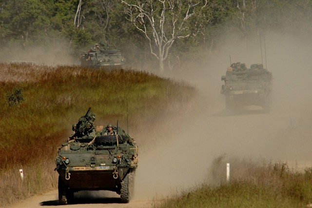 Soldiers advance on Camp Raspberry in their Stryker vehicles for a simulated attack.