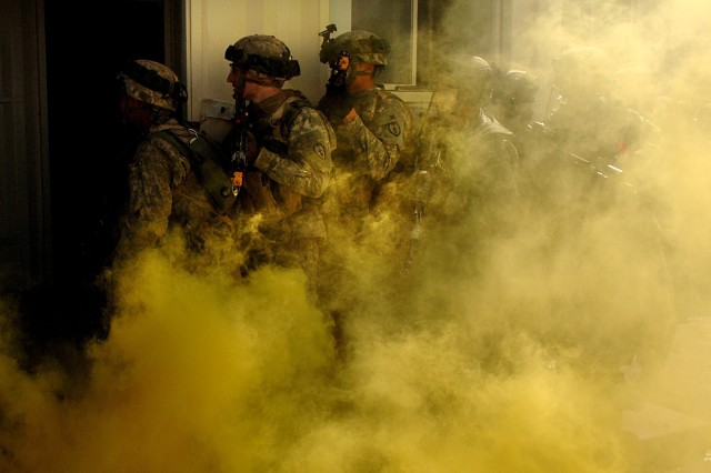 Soldiers enter a building where role-playing insurgents are holed up.