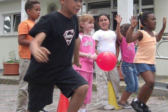 Youth at Darmstadt School-Age Services summer camp prepare to race in a balloon relay during the first week of camp