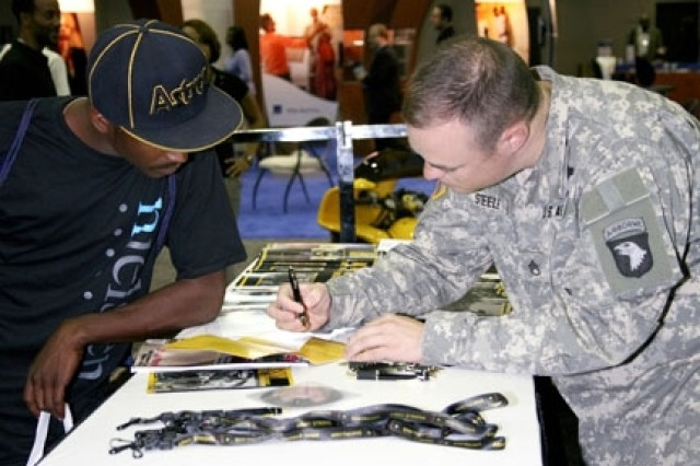Sgt. 1st Class Michael Steele, a local Detroit recruiter spends time with convention attendants at the Army exhibit.