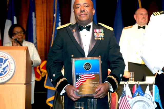 Maj. Gen. John R. Hawkins, III recieves the Roy Wilkins Award during the Armed Services & Veteran Affairs Dinner at the NAACP Convention in Detroit, Mich. on Wednesday.