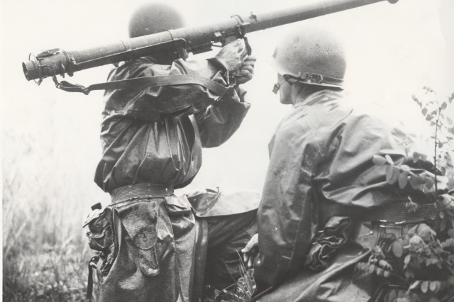 Unidentified U.S. Army soliders operating as a Bazooka team in combat against North Korean forces fire at enemy tanks near the front line,Osan Korea, 5 July 1950. (Korean War Signal Corps Photograph Collection)