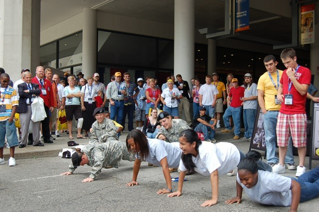 Harmony in Motion challenge students from the audience to a push-up contest for Army t-shirts.
