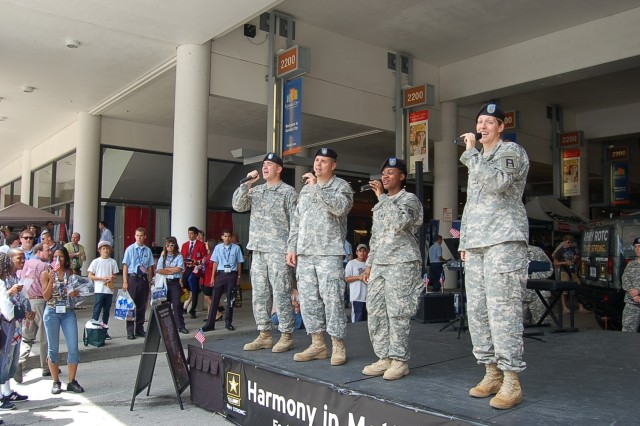 Harmony In Motion from Fort Carson, Co. sing a mix of patriotic, oldies and classic pop songs during daily performances for students, teachers, parents and advisors at the outdoor Army exhibit during the Skills USA National Convention in Kansas City, Mo.