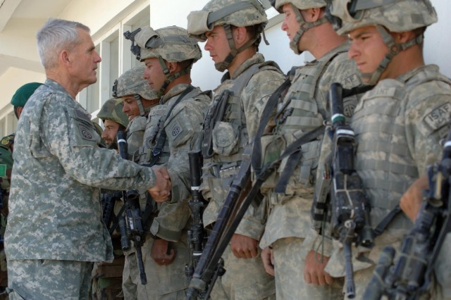 Gen. Dan McNeil congratulates U.S. and Afghan Soldiers who made it safe for the children to return to school.