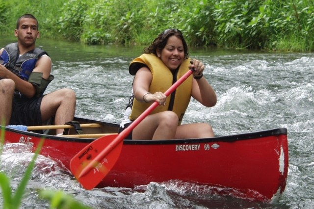 Efrain Rivera, Baumholder High School, and Denisse Torres, Ansbach High School, canoe the Wiesent River.