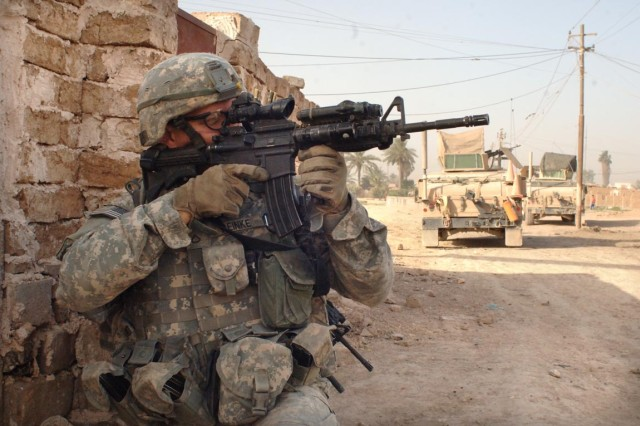 Pfc. Andrew Reinke scans his sector for snipers.