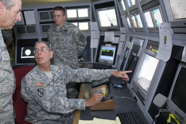 Soldiers monitor a network of border surveillance cameras.